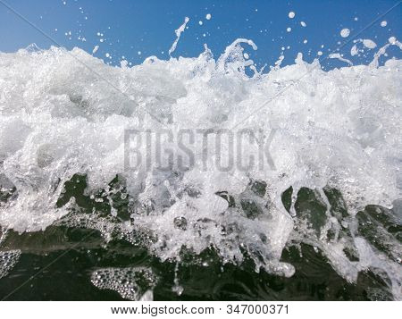 The low tide from the sandy beach. Ocean waves are splashing on the shore. stock photo