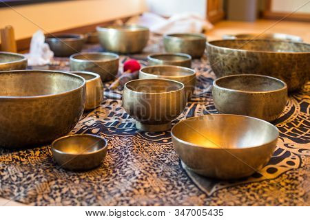 Tibetan singing bowls are a type of bell that vibrates & produces a deep tone when played. Also known as singing bowls or Himalayan bowls, they are said to promote relaxation & healing. stock photo