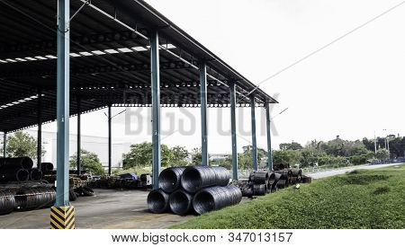 Raw material of steel wire in starage, high carbon steel wire, Black carbon wire rode business, Steel roll are loading from ship stock photo
