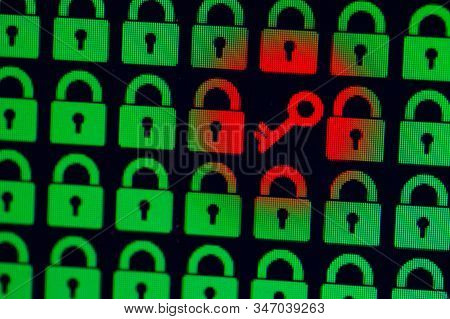 Key as a symbol of access or hacking of open personal information. Universal access password. Green pixel locks and a red key on a black background, close-up stock photo