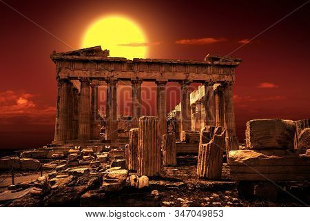 Parthenon on Acropolis of Athens, Greece. It is a top landmark of Athens. Scenic view of famous temple at sunset. Sunny scenery of Ancient Greek ruins in Athens city center. Old Acropolis in sunlight. stock photo