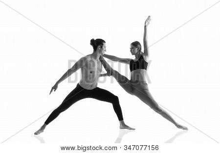 Overall fitness. Couple of athletes isolated on white. Athletic man and woman perform pilates workout. Full body athletic class. Sexy sportsman and sportswoman. Athletic training. Athletic and strong. stock photo