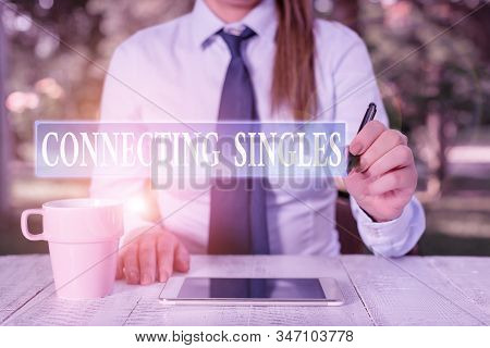 Conceptual hand writing showing Connecting Singles. Business photo showcasing online dating site for singles with no hidden fees Female business person sitting and holding mobile phone. stock photo
