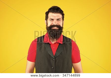 Boys dont cry. Happy hipster. Hipster smile yellow background. Brutal hipster with thick beard hair. Bearded man in casual hipster style. Barbershop. Barbers or hairdressing salon. stock photo