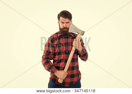 Brutal and bearded. Brutal lumberjack hold axe isolated on white. Hipster keep sharp axe blade at bearded face with brutal look. Brutal man with long beard and mustache going to shave. Barbershop. stock photo