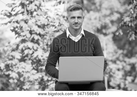 Green office. Inspiring innovations. Businessman inspired by nature guy feel powerful to change world. Man inspired hold laptop. Inspired for start up. Guy with computer in garden. Freelance concept. stock photo