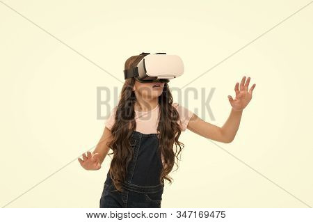 So real. virtual reality technology. Virtual reality is exciting. Girl little kid wear vr glasses isolated on white. Virtual education concept. Modern life. Interaction in virtual space. Cyber gaming. stock photo