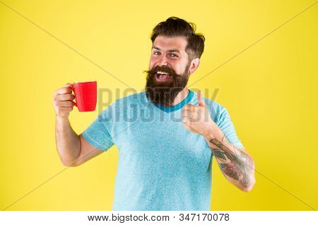 starting day with good drink. good morning coffee. Water balance and health care. Bearded man enjoy morning routine. sip of inspiration. hot drink mug. man casual style drink tea. stock photo
