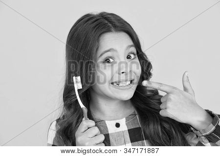 Tooth fairy concept. Loss baby teeth. Baby teeth have to fall out to make way for permanent teeth to grow. Girl showing her mouth without one tooth. Most kids are excited to feel a tooth wiggle. stock photo