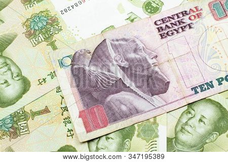 A close up image of an Egyptian ten pound bank note with Chinese one yuan bills in macro stock photo