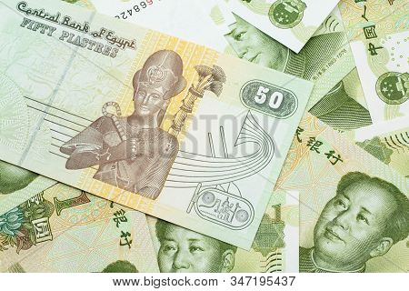 A close up image of an Egyptian fifty pisatres note with Chinese one yuan bills in macro stock photo