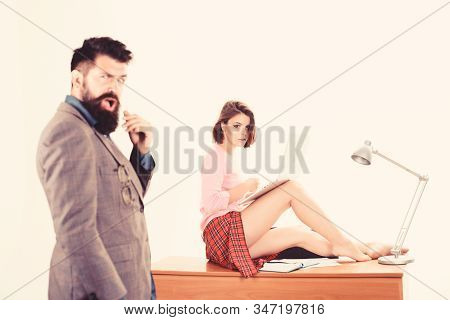 Sexy personal secretary. Full of desire. Sexy lady worker attractive legs sit on table. Ready for inspection. Boss excited about sexy secretary. Sexual attraction. Office manager or secretary stock photo