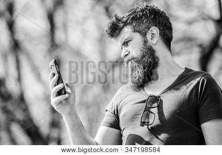 Mature hipster with beard. business talk. brutal businessman with mobile phone. bearded man speaking on cell phone. conversation and discussion. hipster man hold smartphone. searching connection stock photo