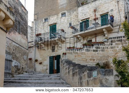 Cobblestone street in the Sassi di Matera a historic district in the city of Matera. Basilicata. Italy stock photo
