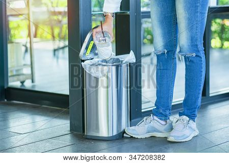 Close Up hand throwing empty litter in recycling bin.Throwing plastic into recycle bin.Waste separation rubbish before drop to garbage bin to save the world,Pollution trash recycling management concept. stock photo