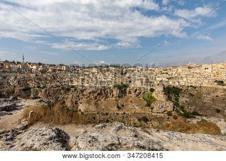 Panoramic view of Sassi di Matera a historic district in the city of Matera, well-known for their ancient cave dwellings from the Belvedere di Murgia Timone,  Basilicata, Italy stock photo