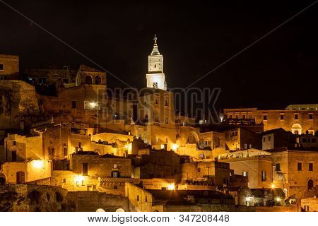 Night landscape of the Sassi of Matera a historic district iin the city of Matera well-known for their ancient cave dwellings. Basilicata. Italy stock photo