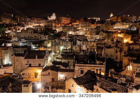 Amazing lighted buildings in ancient Sassi district by night in Matera, well-known for their ancient cave dwellings. Basilicata. Italy stock photo