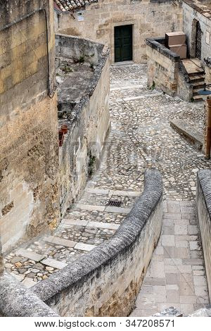 Typical cobbled stairs in a side street alleyway iin the Sassi di Matera a historic district in the city of Matera. Basilicata. Italy stock photo