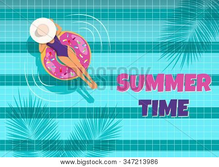 The young woman swims in the pool top view. A woman swims in a pool on an air mattress, enjoying summer vacation. Summer time. Hello Summer, summer time, summer day, summer day background, summer banners, summer flyer, summer design, summer with people in stock photo