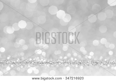 White or light grey bokeh,circle abstract light background,Light grey shining lights, sparkling glittering Valentines day,women day or event lights romantic backdrop.Blurred abstract holiday background. stock photo
