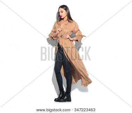 Beauty model girl posing in fashionable spring clothes, wear, apparel.  Beautiful young brunette woman in trendy outfit, fashion make up and accessories isolated on white background Urban street style stock photo