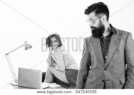 Man bearded boss stand in front of sexy girl working laptop. Office manager or secretary. Sexy lady worker. Sexy personal secretary. Full of desire. Sexual fantasy. Woman fantasizing about coworker stock photo
