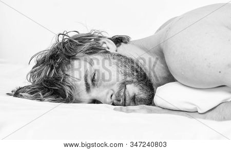 Man attractive macho relax and feel comfortable. Simple tips to improve your sleep. Total relax concept. Man unshaven bearded face sleep relax or just wake up. Guy bearded macho relax in morning stock photo