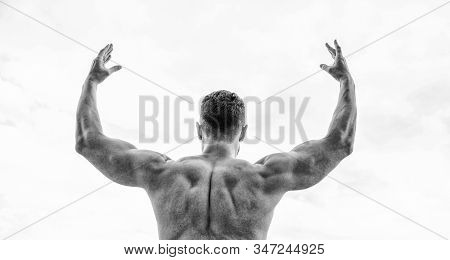 Sport motivation. Champion and winner concept. Man celebrating success. Bodybuilder strong muscular back feeling powerful and superior. Achieve success. Successful athlete. Victory and success stock photo