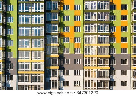 Aerial view of a tall residential apartment building with many windows and balconies. stock photo