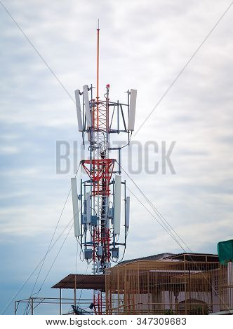 LTE, GSM, 2G, 3G, 4G, 5G tower of cellular communication. Telecommunication tower against the blue sky with clouds. stock photo