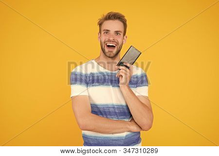 Join digital world. Download application. Guy hold smartphone. Guy happy smiling face showing smartphone screen. Man try application for smartphone. Mobile communication. Mobile operator tariff. stock photo