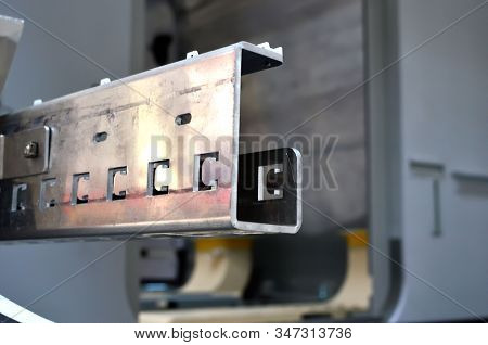 Aluminum profile in the production hall of an industrial plant. Automotive components manufacturing plant. New square metal steel pipes in stock. Warehouse aluminum Industries, background, texture stock photo