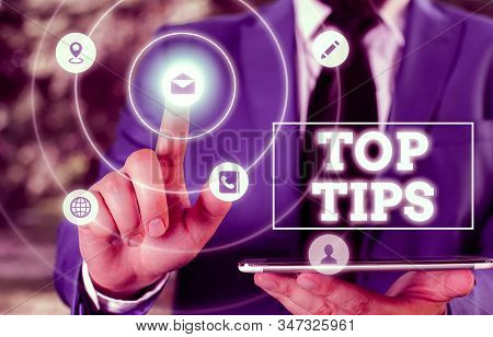 Conceptual hand writing showing Top Tips. Business photo text a small but particularly useful piece of practical advice. stock photo