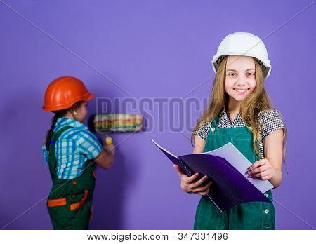 Builder engineer architect. Kid worker in hard hat. Child development. Future profession. Tools to improve yourself. Repair. small girls repairing together in workshop. happy architect. architect stock photo