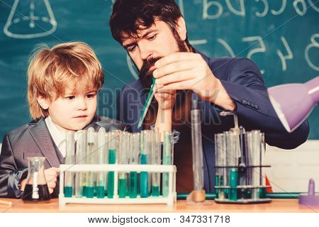 Chemistry experiment. Cognitive process. Kids cognitive development. Mental process acquiring knowledge understanding through experience. Back to school. Cognitive skills. Teacher child test tubes stock photo