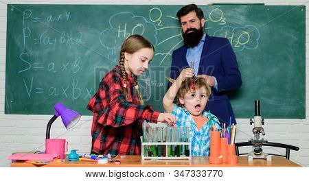 Group interaction communication. Practical knowledge. Teaching kids sharing important knowledge. Study with friends is fun. Younger learn from older. With experience comes knowledge. Formal education stock photo