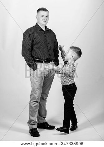 small boy with dad businessman. childhood. trust and values. fathers day. happy child with father. business partner. family day. father and son in business suit. male fashion. family trust. kid trust stock photo