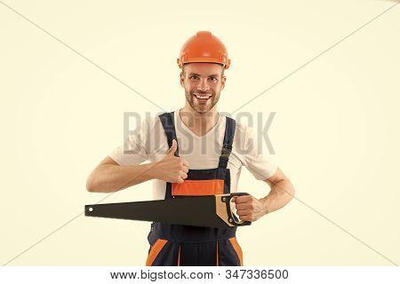 Sharp and effective. Repair service. Repair and renovation concept. Handyman home repair. Repairing and renovating. Home improvement. Man in helmet laborer on white background. Repair workshop. stock photo