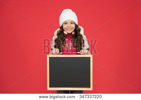 Happy hours. Announcement. Happy girl blank blackboard copy space. Important information. Winter activity advertisement. Time for winter holiday. Winter shopping sales. Skating rink. Active leisure. stock photo