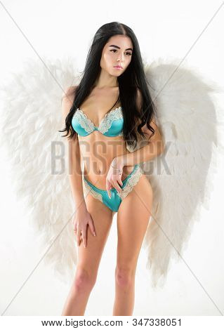 Girl wear lingerie angel feather wings accessory. Femininity and sensuality. Erotic angel. Desirable and tempting lady. Purity and innocence. Attractive sensual woman with angel wings. Fashion model stock photo