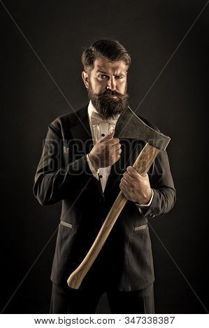 Decision was made. Man brutal hipster with axe. Sharp ax hand confident guy. Masculinity and brutality. Barbershop hairstyle. Firm determination. Brutal barber. Brutal manners. Resoluteness concept. stock photo