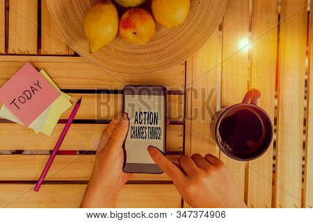 Word writing text Action Changes Things. Business concept for start doing something against problem resolve or achieve it woman computer smartphone drink mug office supplies technological devices. stock photo