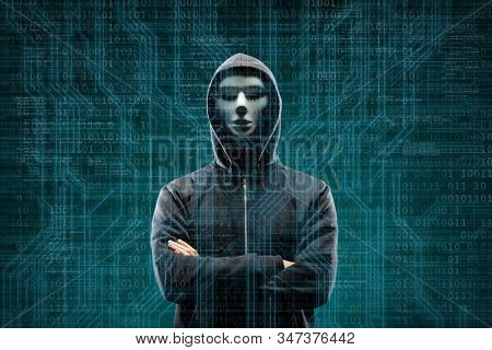 Dangerous hacker over abstract digital background with binary code. Obscured dark face in mask and hood. Data thief, internet attack, darknet fraud, virtual reality and cyber security. stock photo