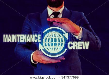 Writing note showing Maintenance Crew. Business photo showcasing responsible for maintenance and repair work of buildings. stock photo