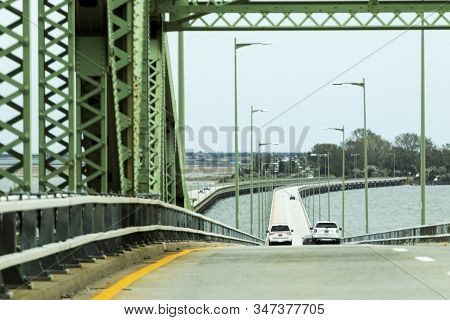 Looking down the Great South Bay Bridge driving on the Robert Moses causeway heading to the beaches on Fire Island New York. stock photo