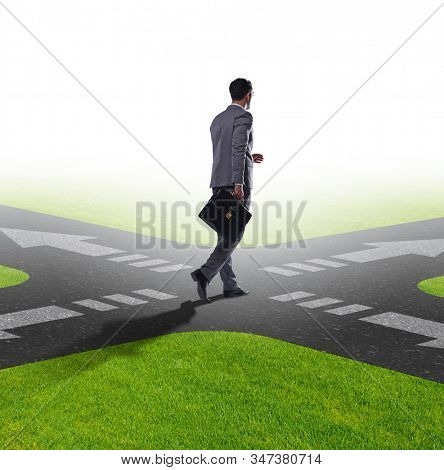 The young businessman at crossroads in uncertainty concept stock photo