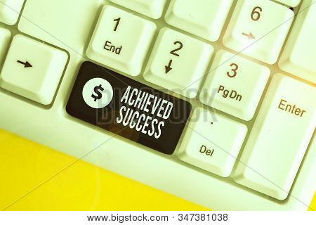 Handwriting text writing Achieved Success. Concept meaning the achievement of desired visions and planned goals White pc keyboard with empty note paper above white background key copy space. stock photo