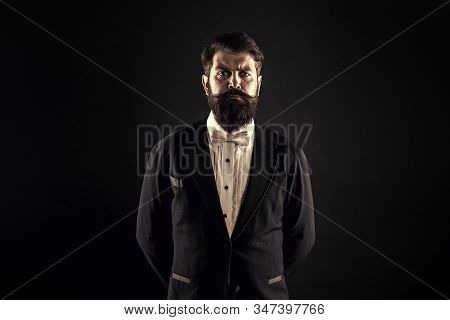 Retro hipster. Hipster with stylish haircut. Brutal hipster with thick beard hair. Bearded man in classic hipster style. Barbershop or barbers. Hairdressing salon, vintage filter. stock photo
