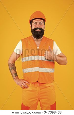 Good job. Man engineer protective uniform orange background. Engineering career concept. Architect builder engineer. Safety apparel for construction industry. Bearded brutal hipster safety engineer. stock photo
